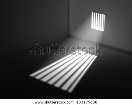 Light through the latticed prison window - stock photo