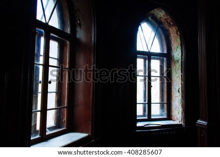 Light through the old wooden windows in an abandoned building dark gloomy