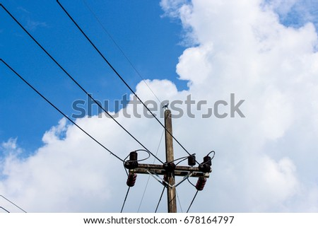 Light towers and wires Under the sky