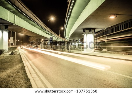 light traces on traffic junctions at night - stock photo