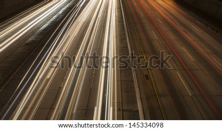 Light trail from highway - stock photo