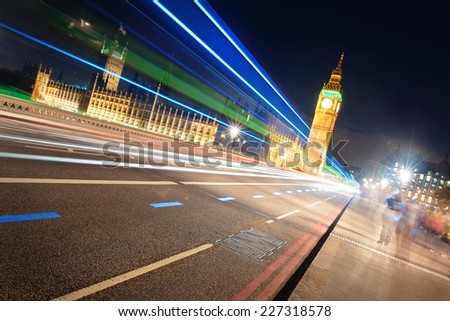 Light trail on Westminster Bridge with Big Ben at night in London.