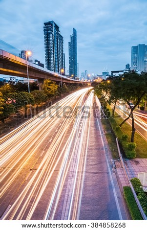 light trails from moving cars on highway at night ,bangkok , thailand. - stock photo