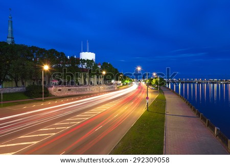 Light trails in old and beautiful city embankment of Riga at night time