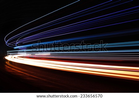 Light trails in tunnel. Art image. Long exposure photo taken in a tunnel. - stock photo