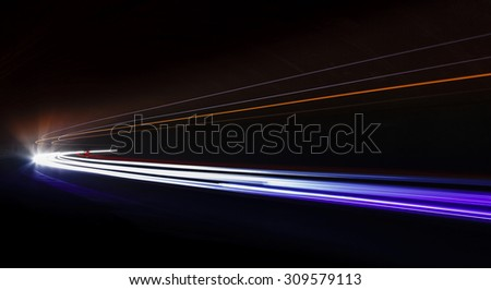 Light trails in tunnel. Art image. Long exposure photo taken in a tunnel.
