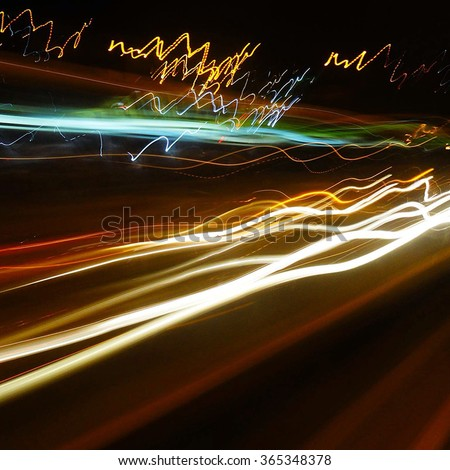 Light trails lines photography in slow shutter speed. Fast cars in the city night   - stock photo