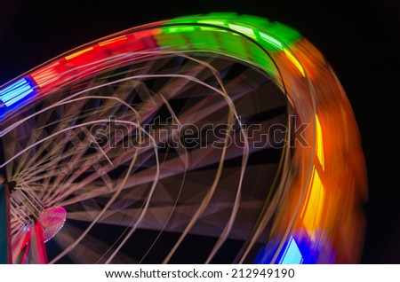 light trails of a ferris wheel in motion - stock photo