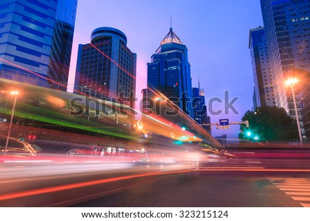 Light trails on a city street at dusk,China - stock photo