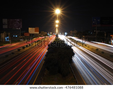light trails on road in city night scene , thailand