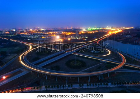 light trails on the modern building background in shanghai china - stock photo