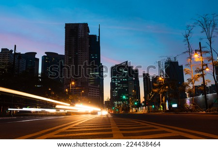 Light trails on the street at dusk in Manila, Philippines - stock photo