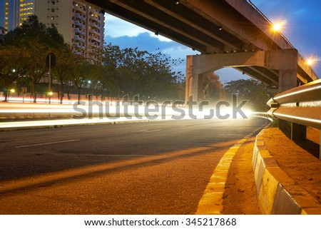 Light trails on the  street at night - stock photo
