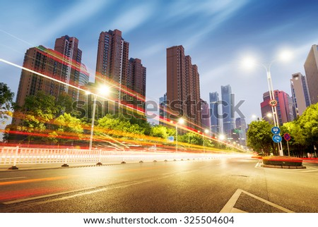 light trails on the street in shanghai ,China. - stock photo