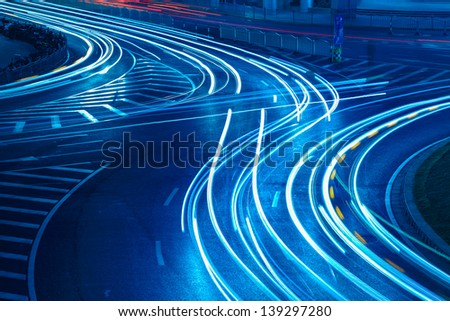 light trails on the urban road,abstract background - stock photo