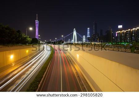 light trails on urban road - stock photo