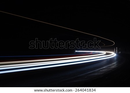 Light tralight trails in tunnel. Art image. Long exposure photo taken in a tunnel.