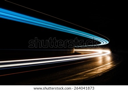 Light tralight trails in tunnel. Art image. Long exposure photo taken in a tunnel ils in tunnel.