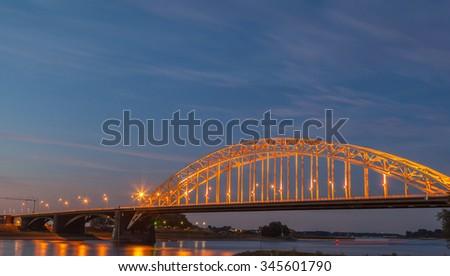 Light up bridge at sunset with twilight - stock photo