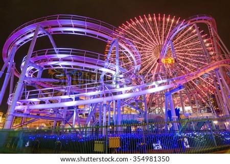 Light up of amusement park in Yokohama at night - stock photo