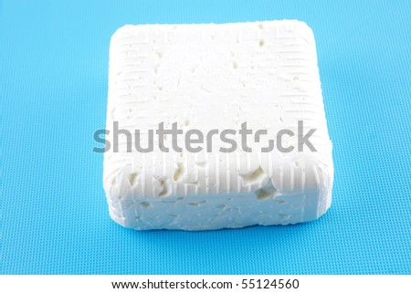 light white cheese on dishware over white - stock photo