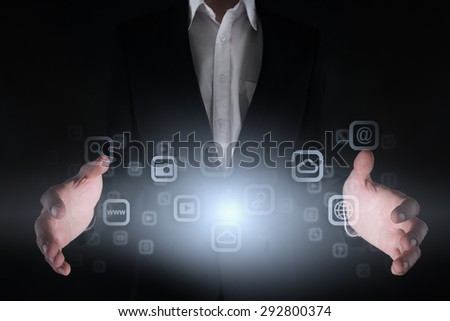 Light with icons in the hands of a businessman. Business concept. Internet concept.