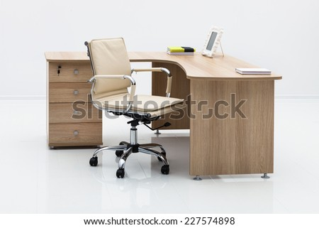 light wood desk in the office - stock photo