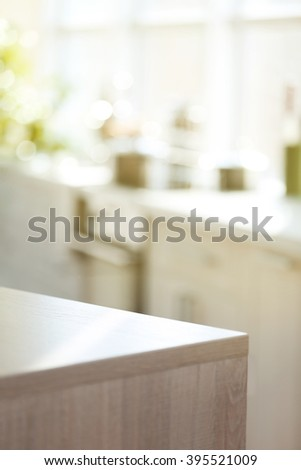 light wooden kitchen table on blurred stock photo 395521009