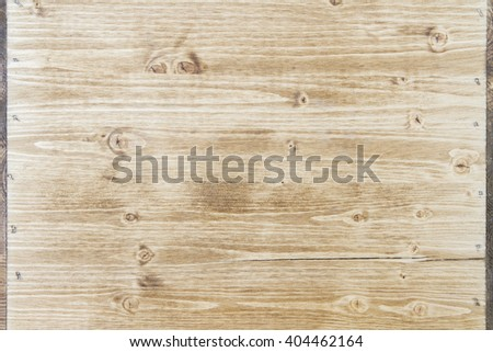 Light wooden texture with iron nails on sides. Mock up - stock photo