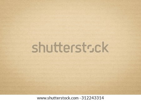 Light yellow brown cream color tone corrugated cardboard paper texture patterned background: Recycled cardboard textured pattern grunge detailed backdrop in creme brown toned colour with vignette  - stock photo