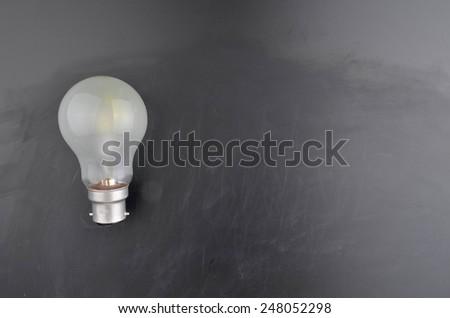 Lightbulb and Blackboard - stock photo
