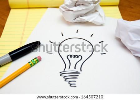 Lightbulb Drawn On Paper - stock photo