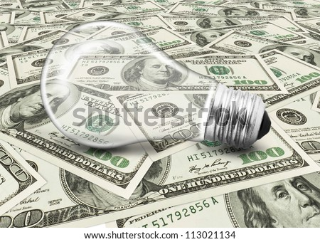 lightbulb on money dollars background - stock photo