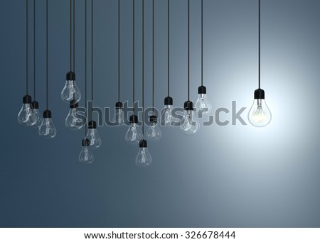 lightbulbs  and one lighting bulb on blue background, idea concept - stock photo