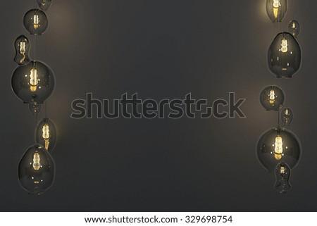 Lightbulbs and the dark wall 3D Render - stock photo