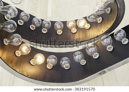 Lighted bulbs, detail of a light bulb to illuminate and give light, electricity - stock photo