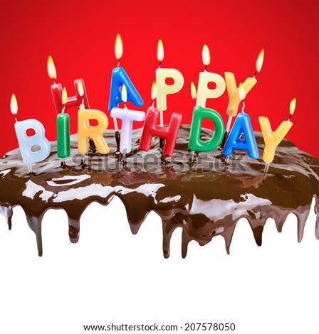 lighted candles on his birthday on a birthday cake. Bottom white space for text or congratulations - stock photo