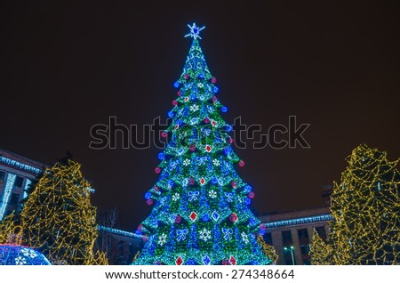 Lighted Christmas tree in night city park in 2015 - stock photo