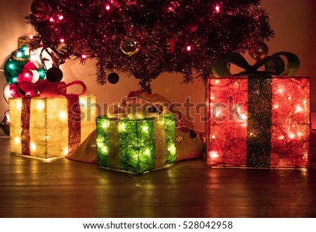 Lighted LED gift boxed under decorated Christmas tree