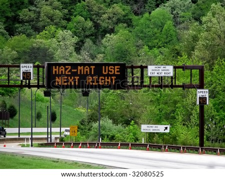lighted overhead highway sign hazmat use next righ