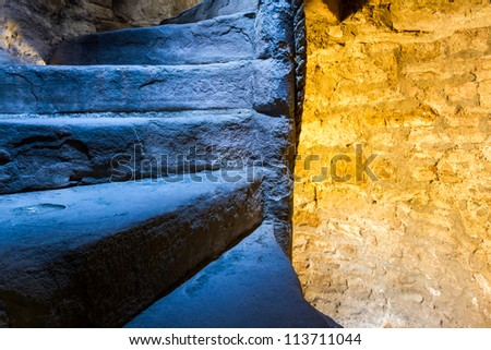 Lighted stone staircase in a Scotland castle - stock photo