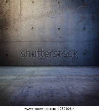 Lighted wall of a concrete room. - stock photo