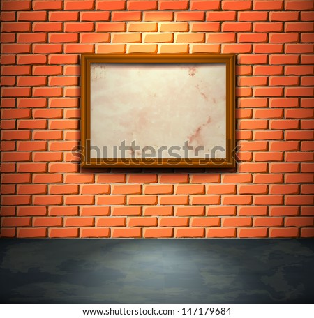 Lightened brick wall with aged empty frame