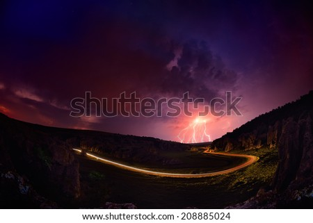 Lightening and storm over hills in the night, Dobrogea, Romania - stock photo