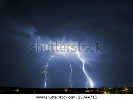 Lightening over the landscape in the summer night.