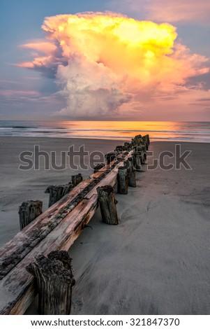 Lightening strikes off the Atlantic Coast from a passing thunderstorm at Folly Beach in Charleston South Carolina. - stock photo