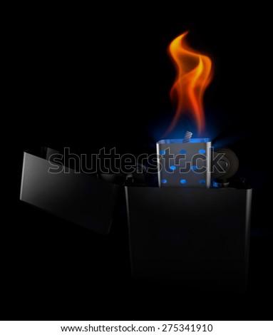 Lighter metal in the dark, at night - stock photo