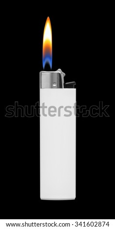 Lighter with fire on black background - stock photo