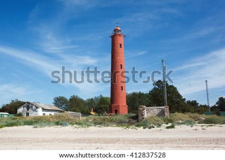Lighthouse Akmenrags, Latvia. Lighthouse on the coast of the Baltic Sea.  - stock photo