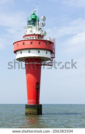 Lighthouse Alte Weser in the North Sea - stock photo